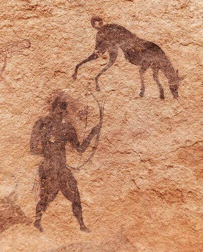 Väggmålning med människan och hunden.