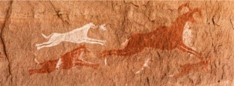 Hundens roll: En grottmålning med hundar som jagar en hjort.