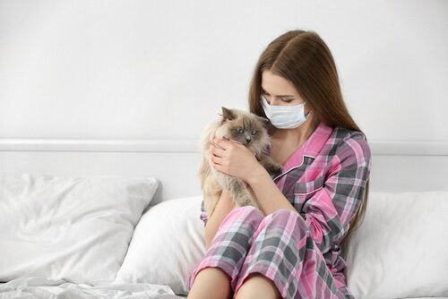 Woman with a cat allergy cuddling a cat