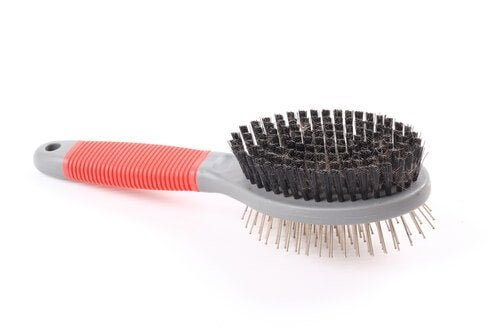 A dog grooming brush