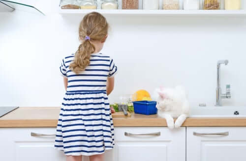 A girl working in the kitchen.