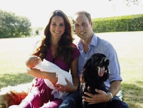 Prince William and Kate with their dog and baby.