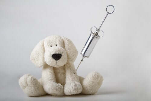 A toy dog with an injection needle.