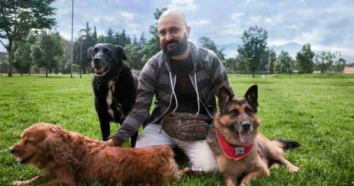 A man with three dogs.