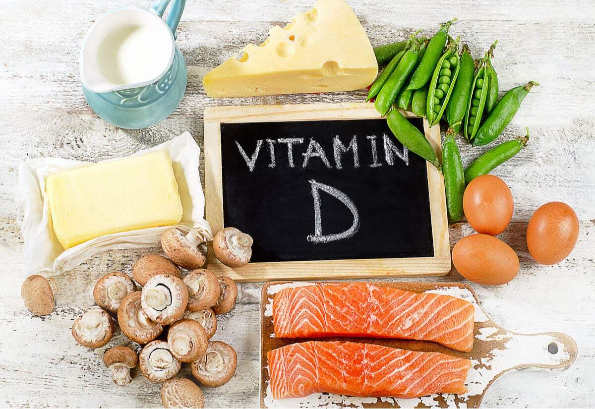 """A variety of vitamin D sources surrounding a small blackboard that says """"vitamin D""""."""