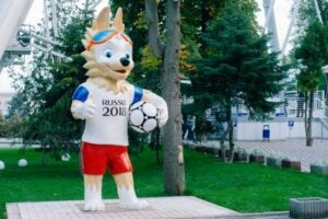 Russia's wolf mascot holding a soccer ball.